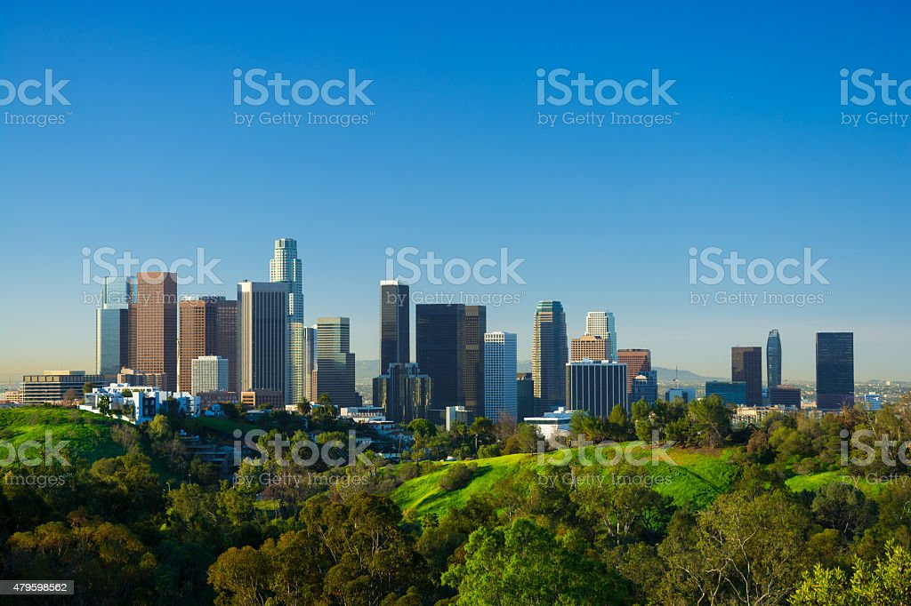 Los Angeles dowtown skyline with lush green hills stock photo