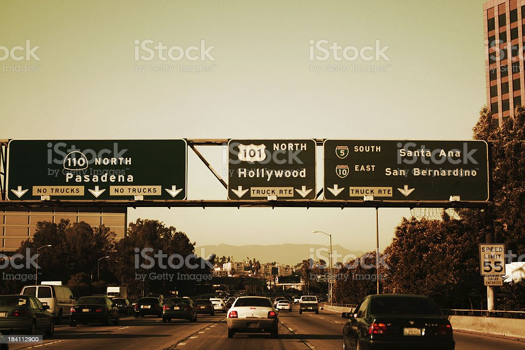 Los Angeles Freeway exits on a sunny day. stock photo