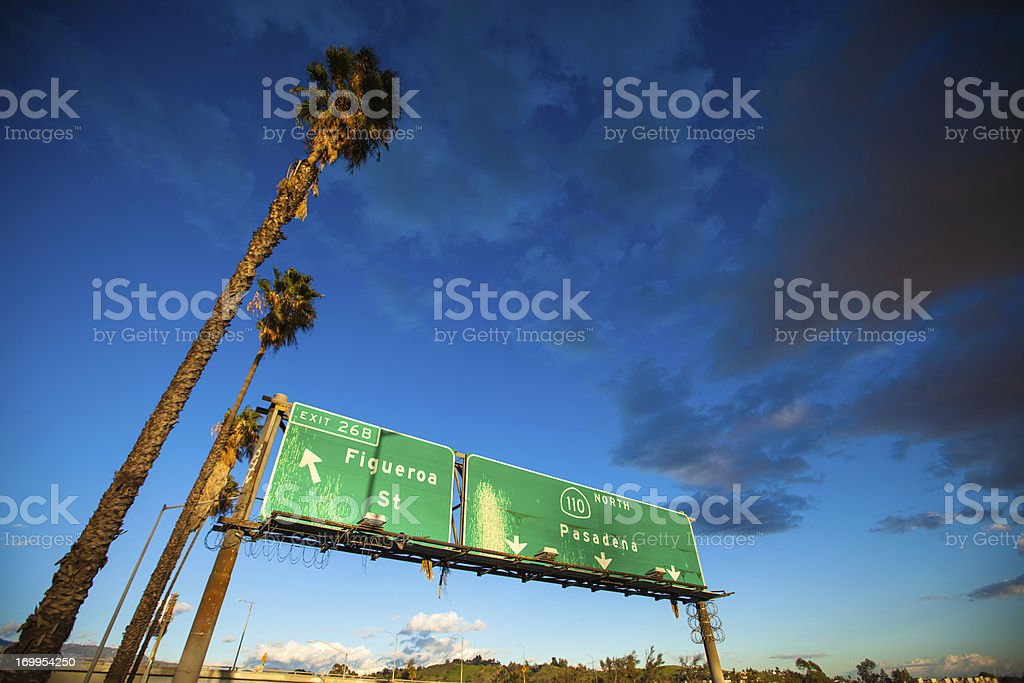 Los Angeles Freeway Sign, Palm Trees, and Deep Blue Sky stock photo