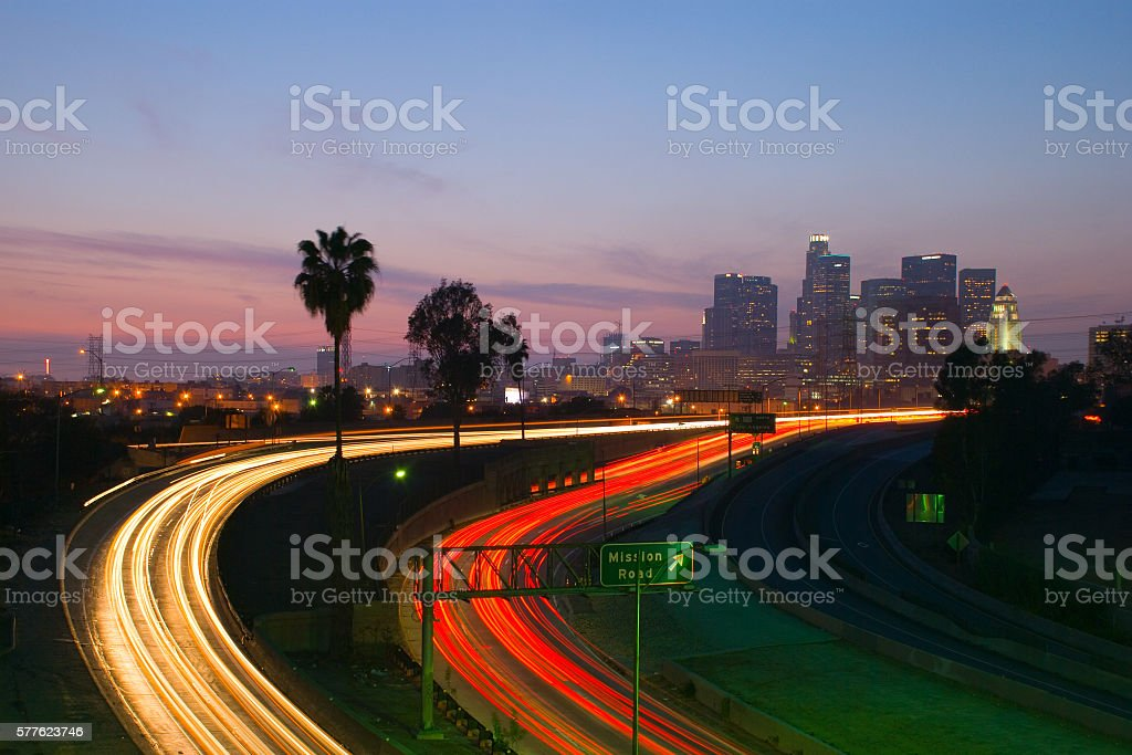 Los Angeles Skyline and Freeway at Dusk with Light Trails stock photo