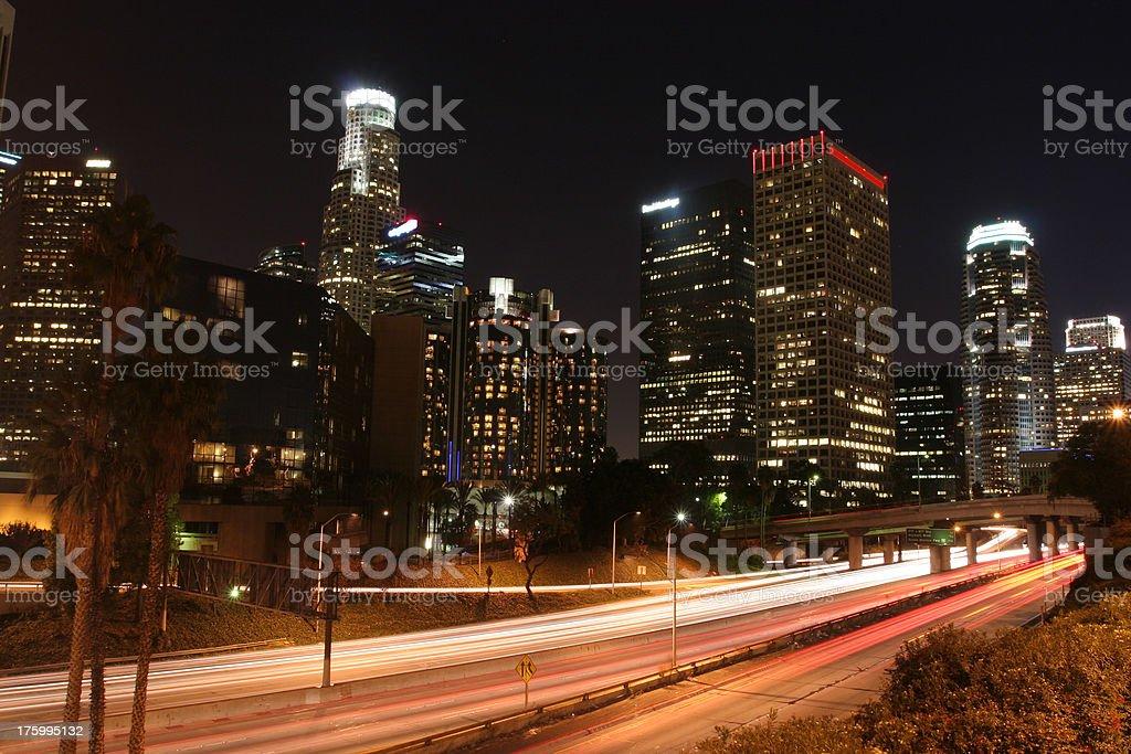 Los Angeles Skyline & Freeway at night stock photo