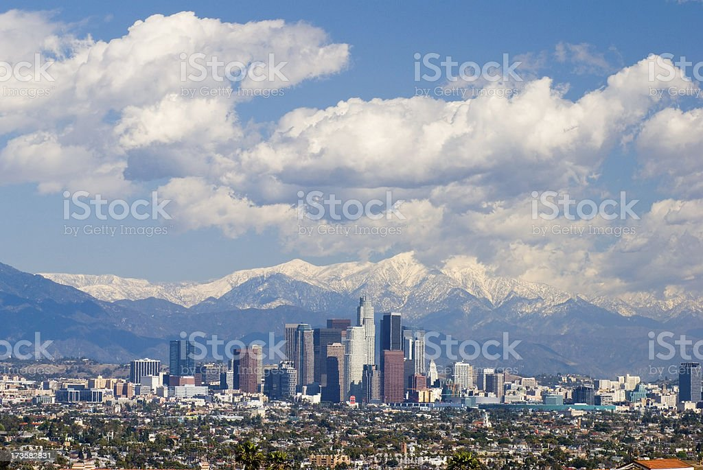 Los Angeles Skyline, Mountains, and Clouds stock photo