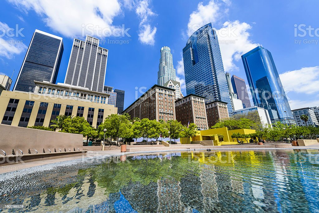 Los Angeles skyline skyscrapers cityscape reflecting pond from Pershing Square stock photo