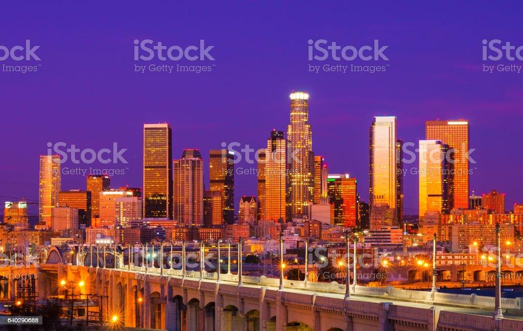 Los Angeles Skyline with Orange Sunrise Reflections and Purple Sky stock photo