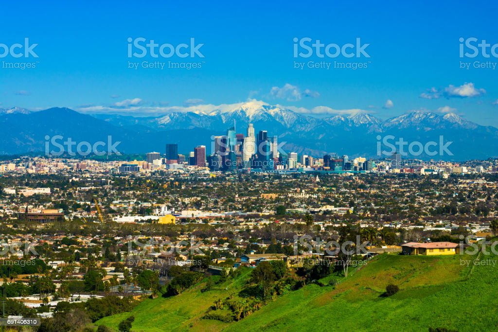 Los Angeles Skyline with Snow-capped Mountains from a Hill stock photo