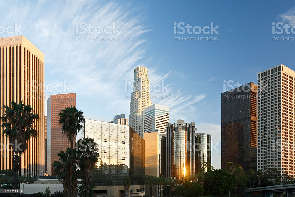 Los Angeles skyline with the reflection of the sunrise royalty-free stock photo