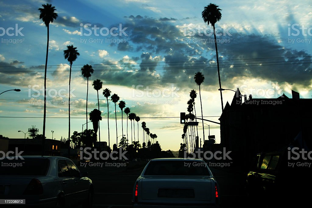 Los Angeles Street at Sunset with palmtrees stock photo