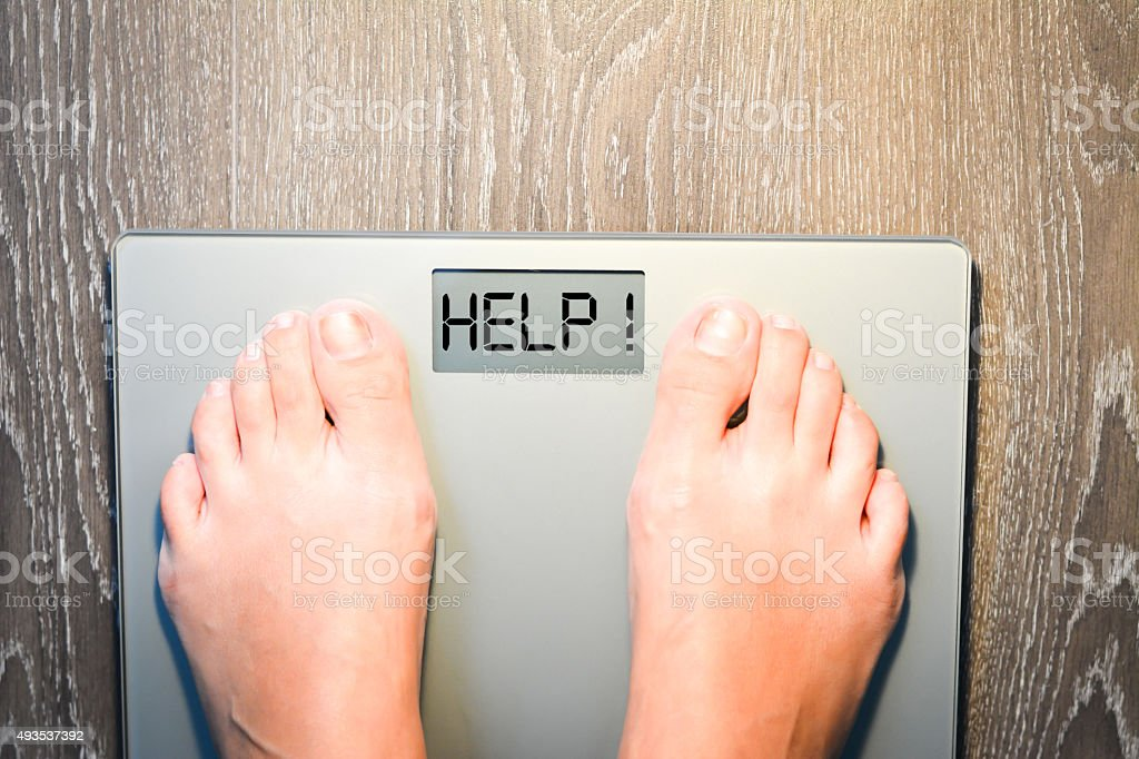 Lose weight concept with person on scale measuring kilograms stock photo