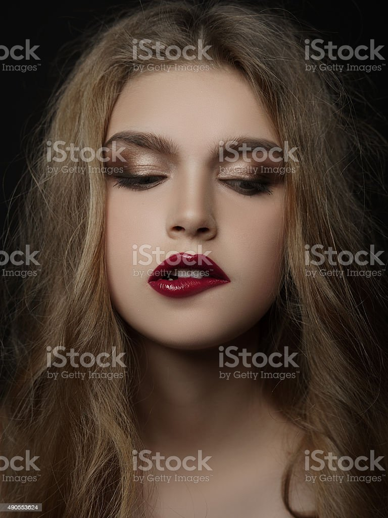 Сlose-up portrait young girl, biting her lip,  fashion make-up stock photo