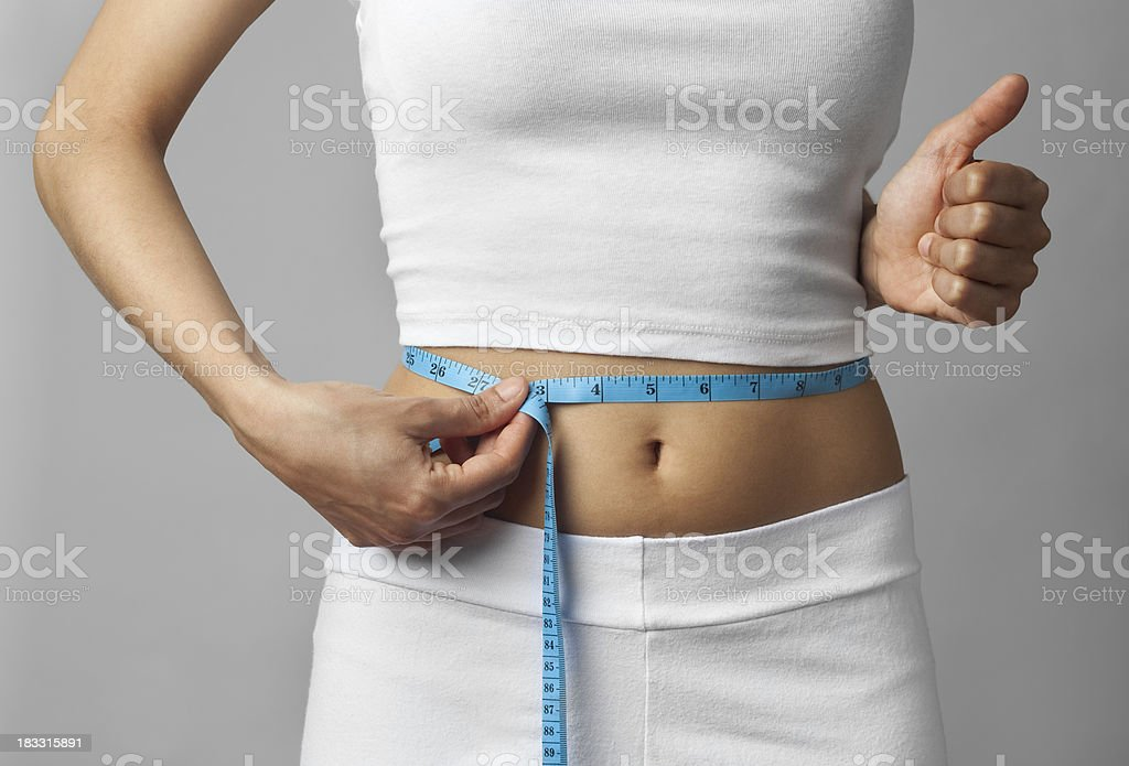 Losing weight thumbs up royalty-free stock photo