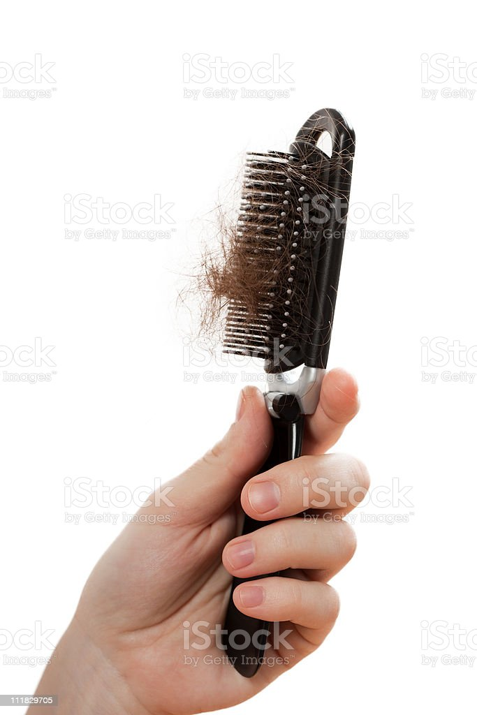 Loss hair comb in women hand stock photo