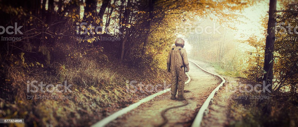 Lost astronaut in the forest stock photo