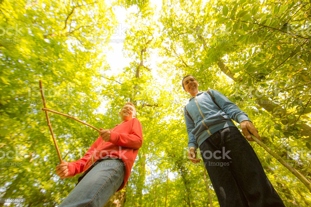 lost boys in the forest stock photo