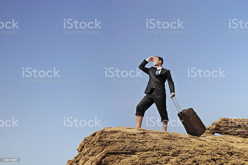 Lost businessman searching for a way stock photo