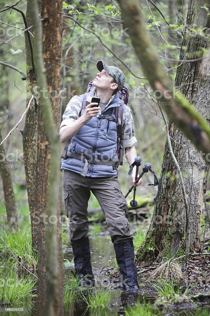 lost hiker in forest with mobile satelite navigation device stock photo