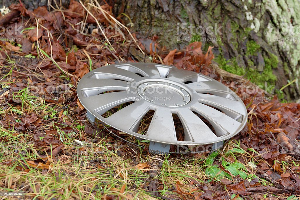 Lost hubcap stock photo