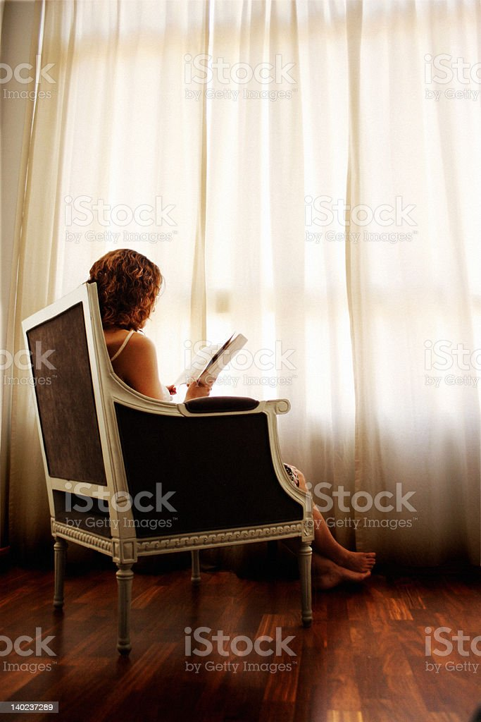 Lost in a good book stock photo