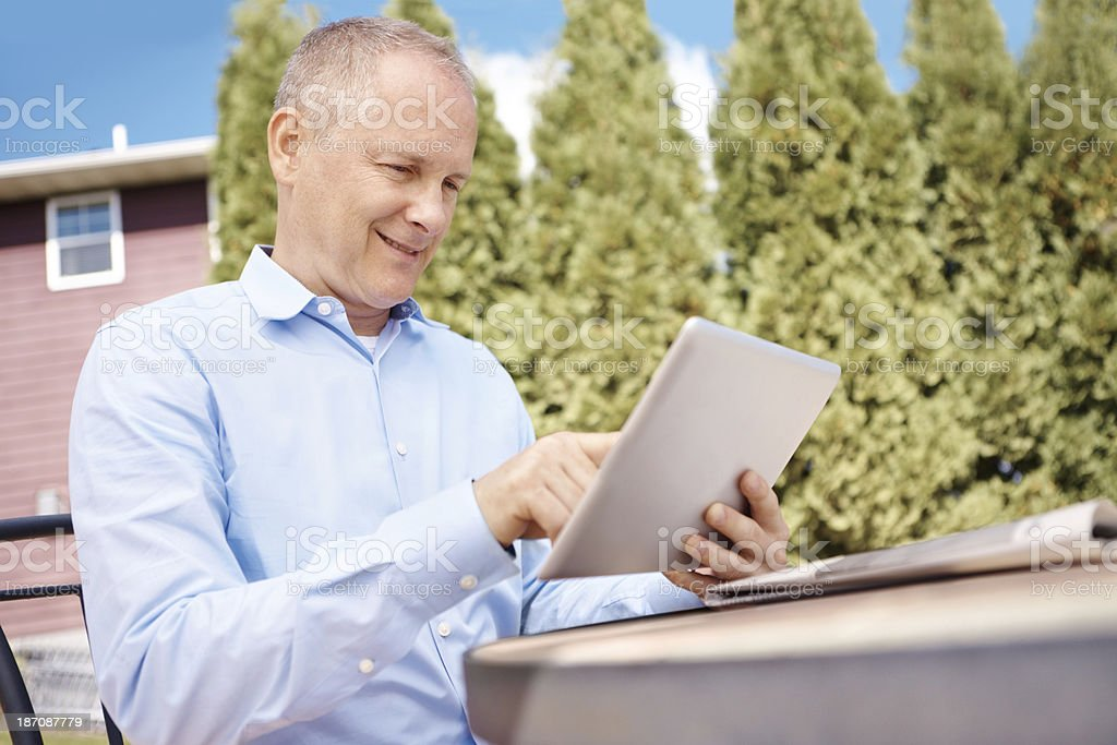 Lost in his e-reader royalty-free stock photo