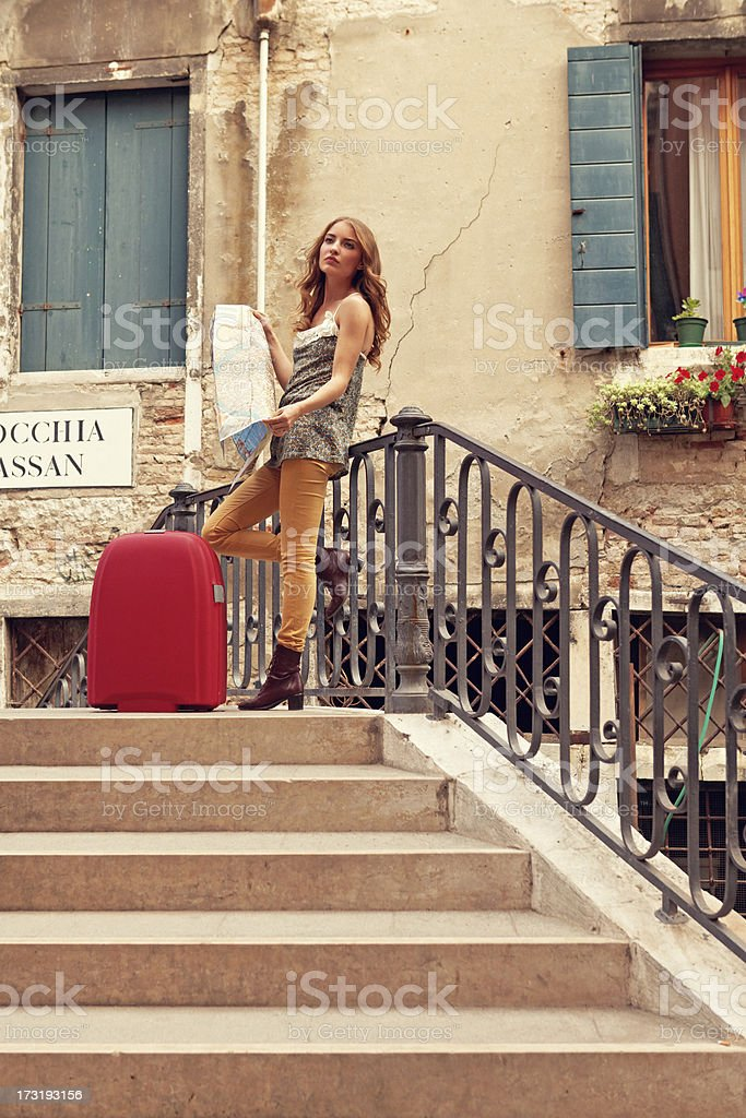 lost in Venice - young tourist holding map royalty-free stock photo