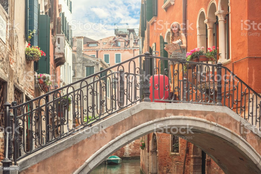 Lost in Venice - young tourist holding map stock photo