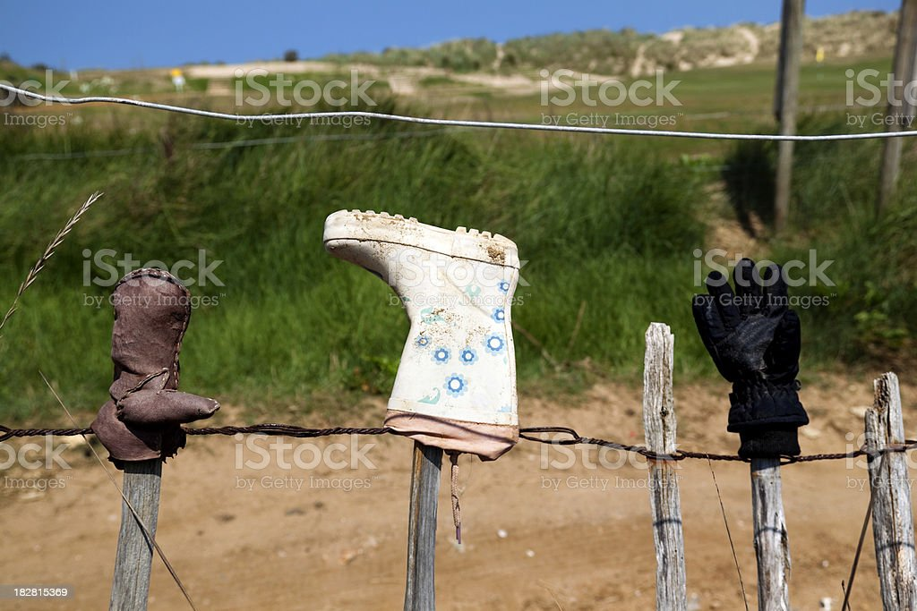 Lost items on a fence royalty-free stock photo