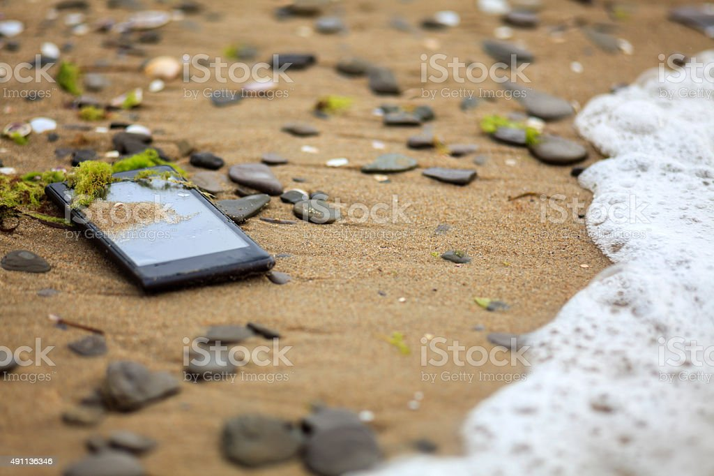 Lost Phone In The Sand stock photo