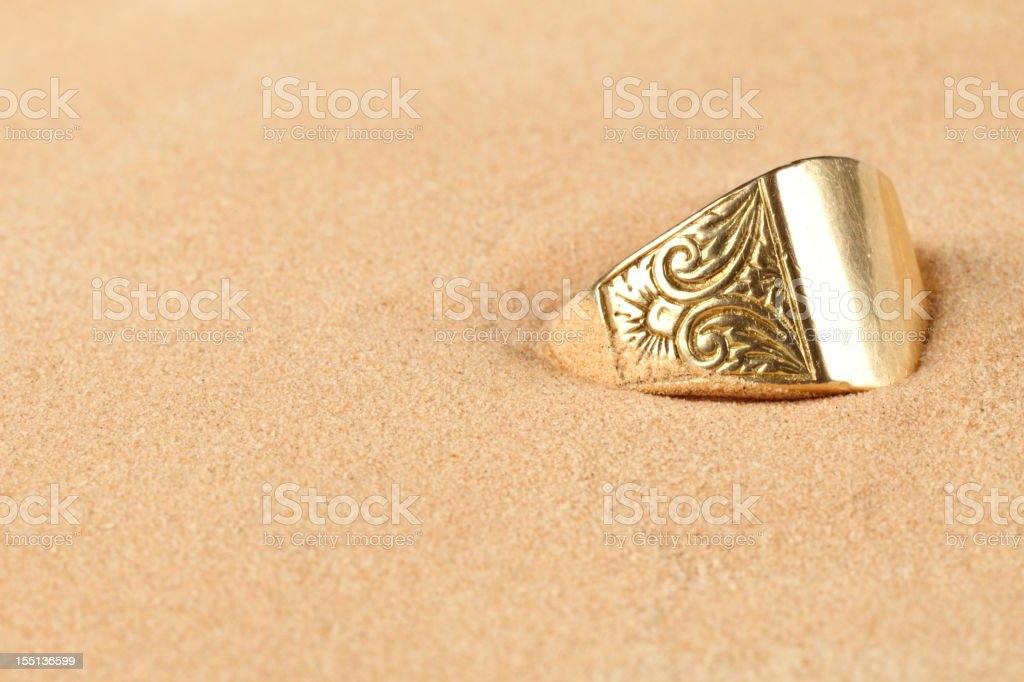Lost ring in the sand stock photo