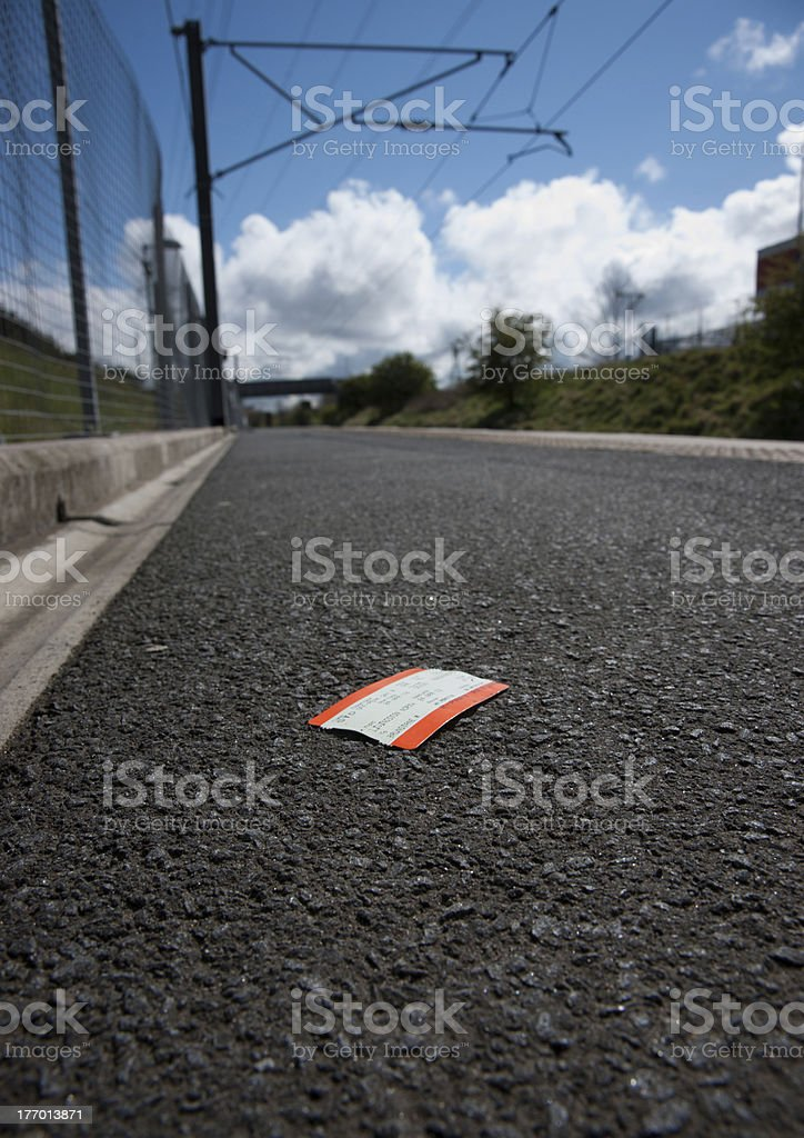 Lost ticket on railway platform stock photo