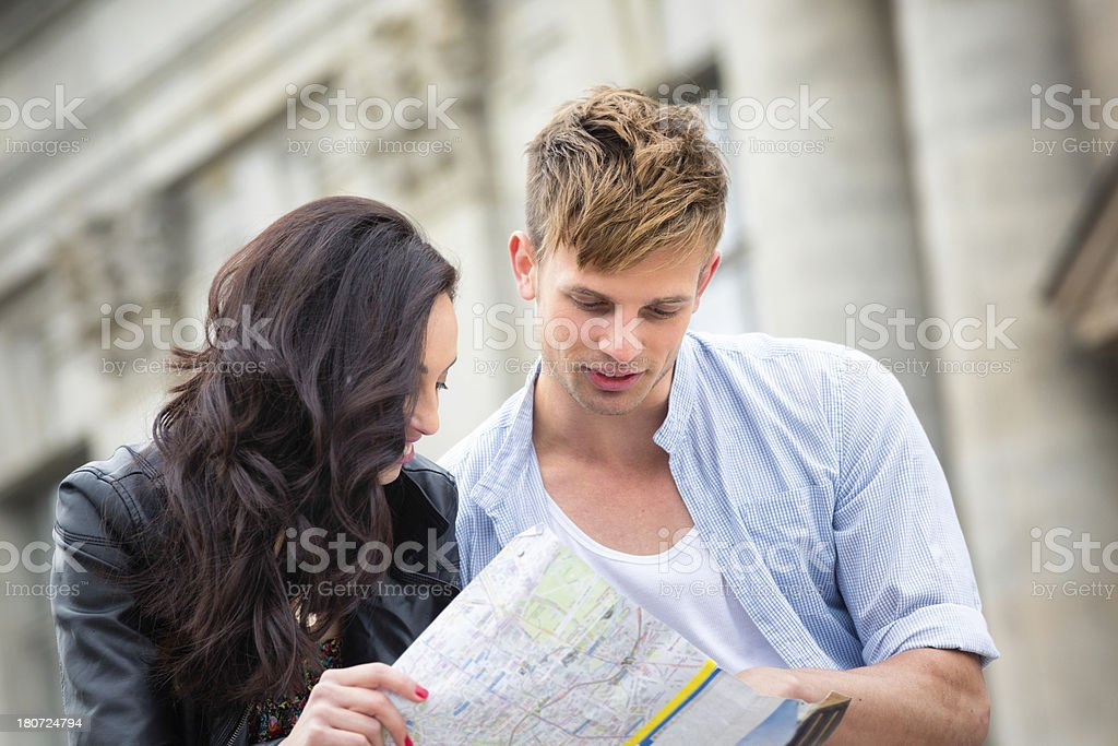Lost tourists looking at map royalty-free stock photo