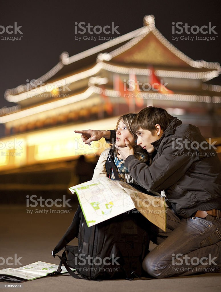 Lost tourists with map royalty-free stock photo