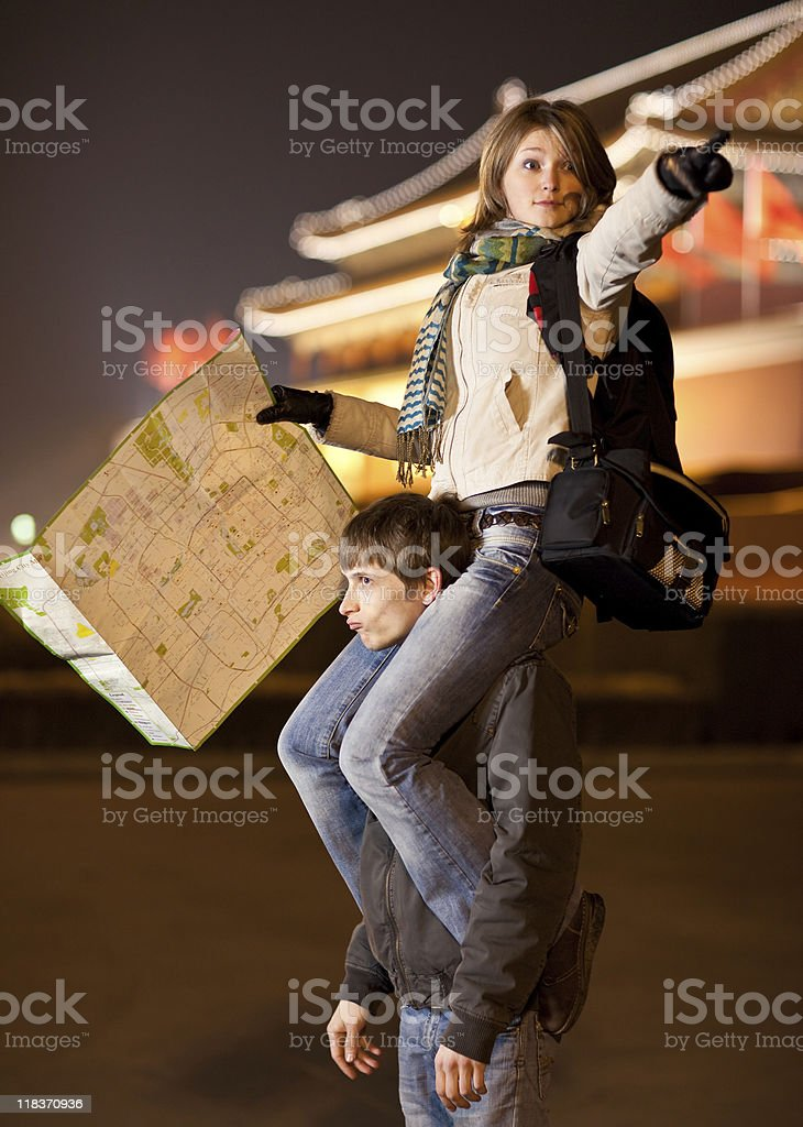 Lost tourists with map stock photo