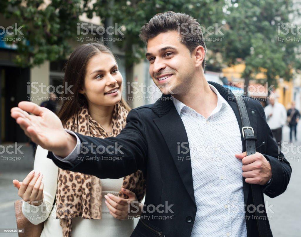 Lost woman asking  stranger stock photo