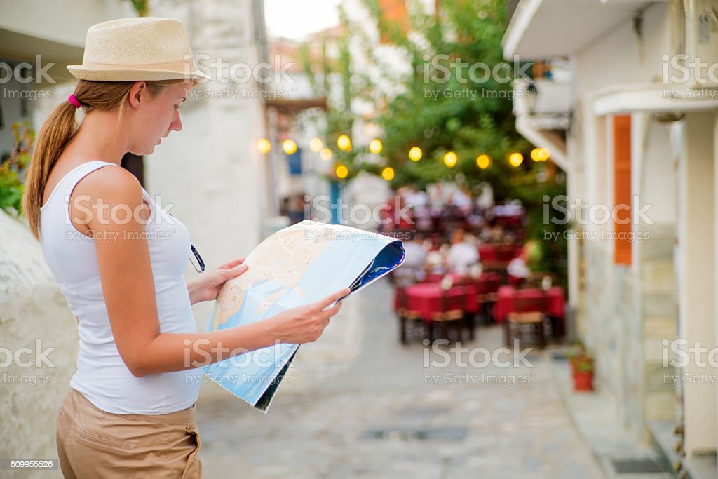 Lost woman in the countryside holding a map stock photo