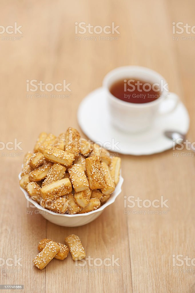 lot cookies sprinkled sesame tasty white plate cup tea royalty-free stock photo