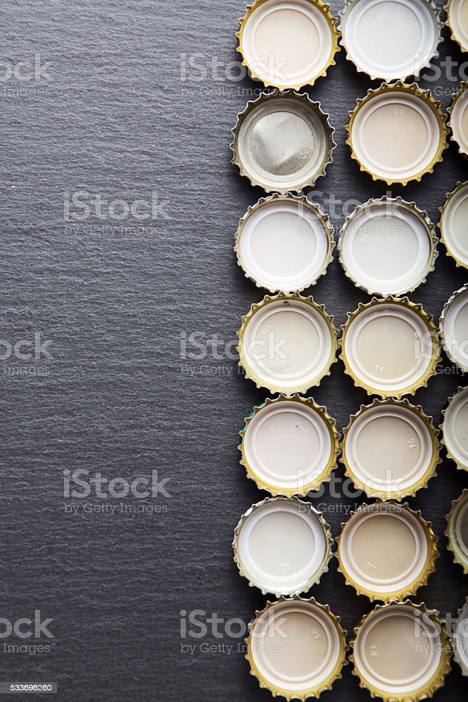 lot of caps of beer, top view stock photo