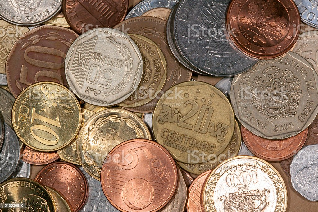 Lot of differente colored world coins stock photo