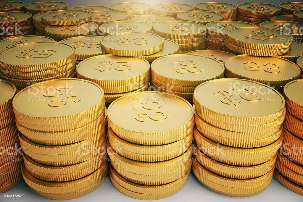lot of gold coins in stacks stock photo