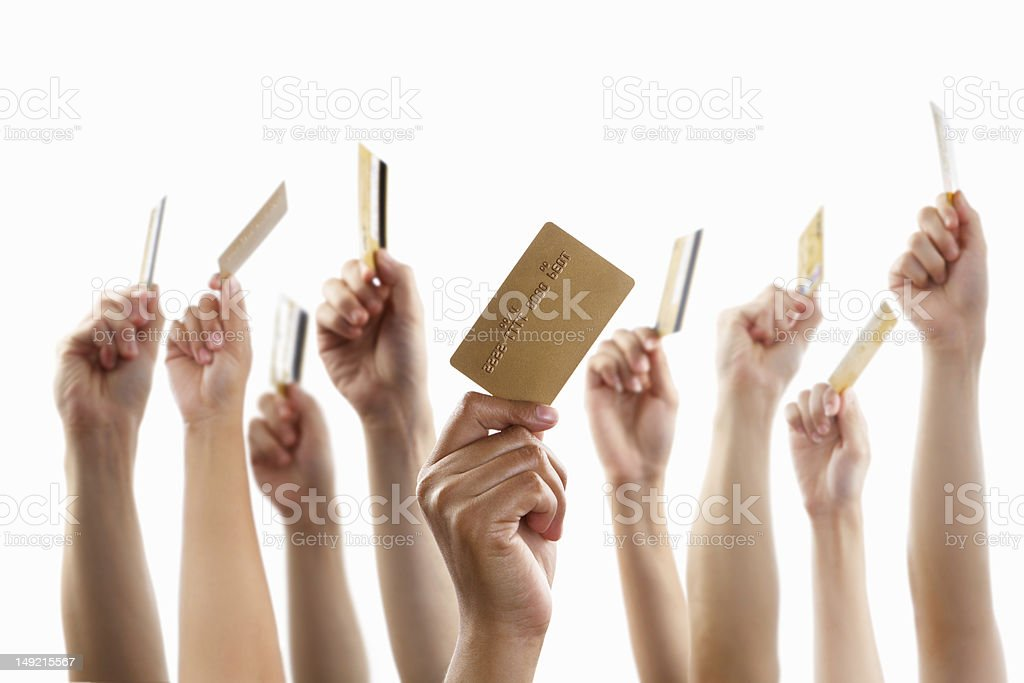 Lot of hands holding gold credit card royalty-free stock photo