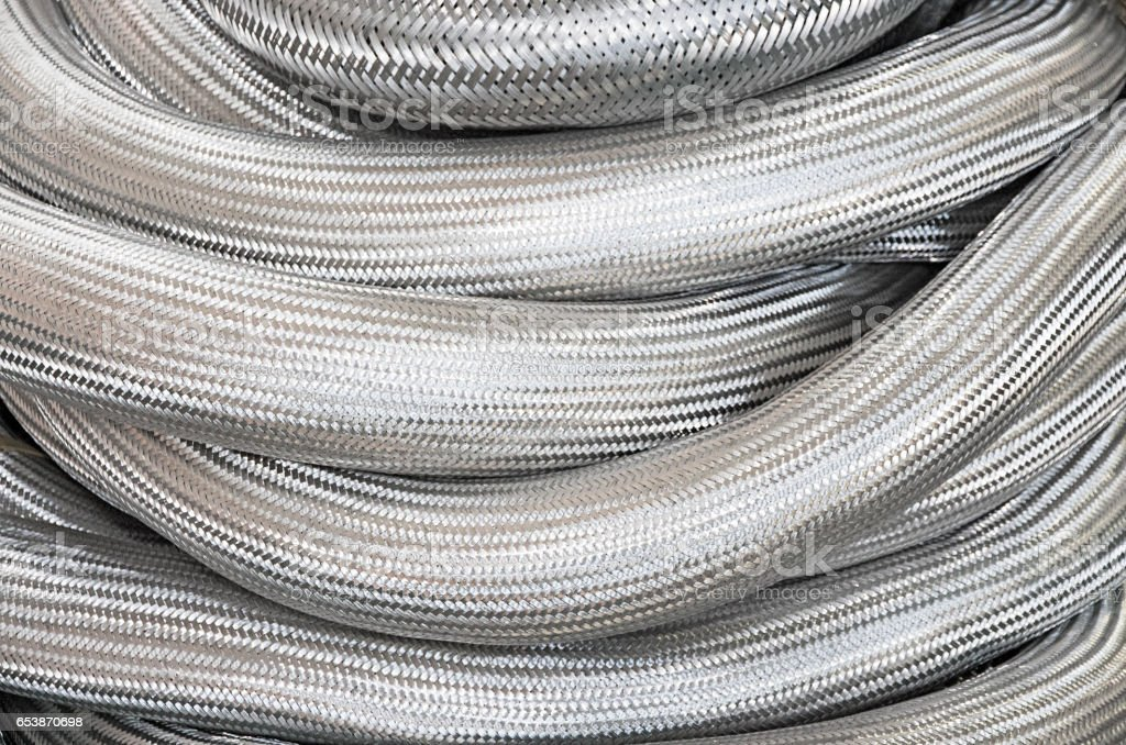 A lot of metal hoses stock photo