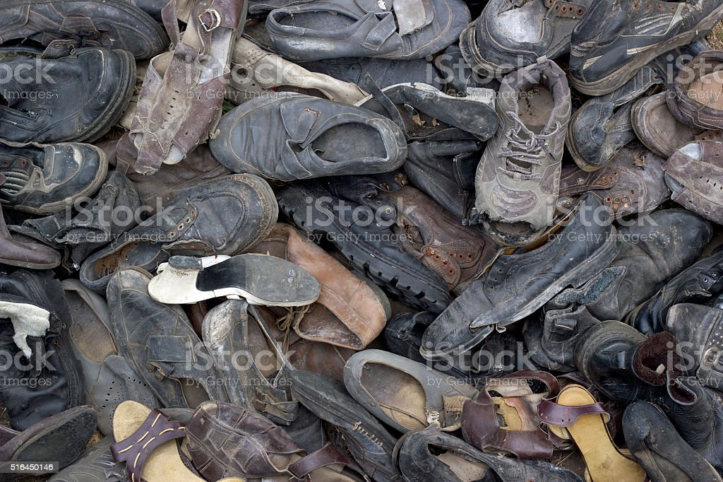 lot of old trash shoes. Background image stock photo