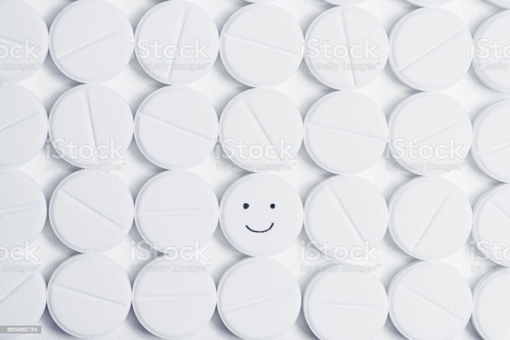 A lot of pills, one with positive emotion. stock photo