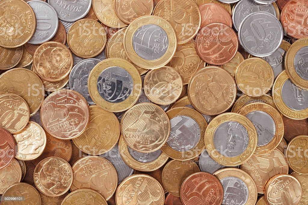 Lot of scattered brazilian real coins stock photo