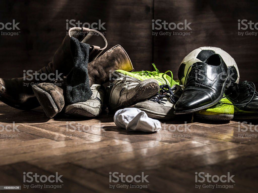 lot of shoes after the party with soccer ball stock photo