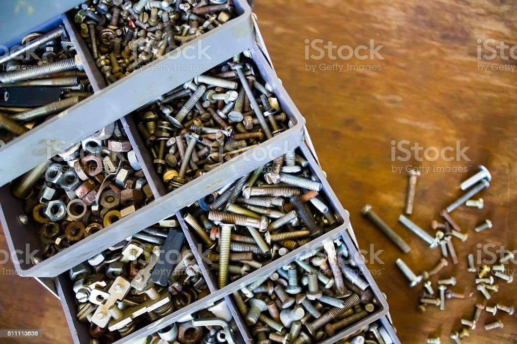Lot of small details screws bolts nuts stock photo