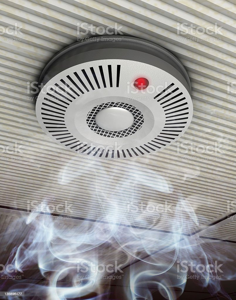A lot of smoke and a fire detector stock photo