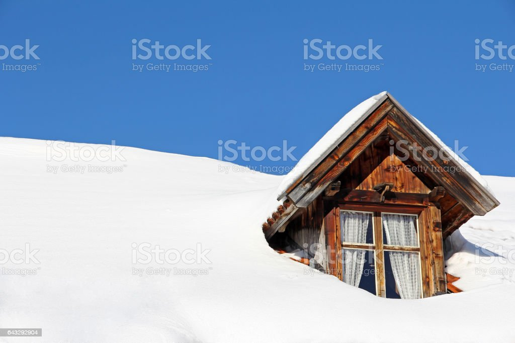 A lot of snow on a house roof stock photo