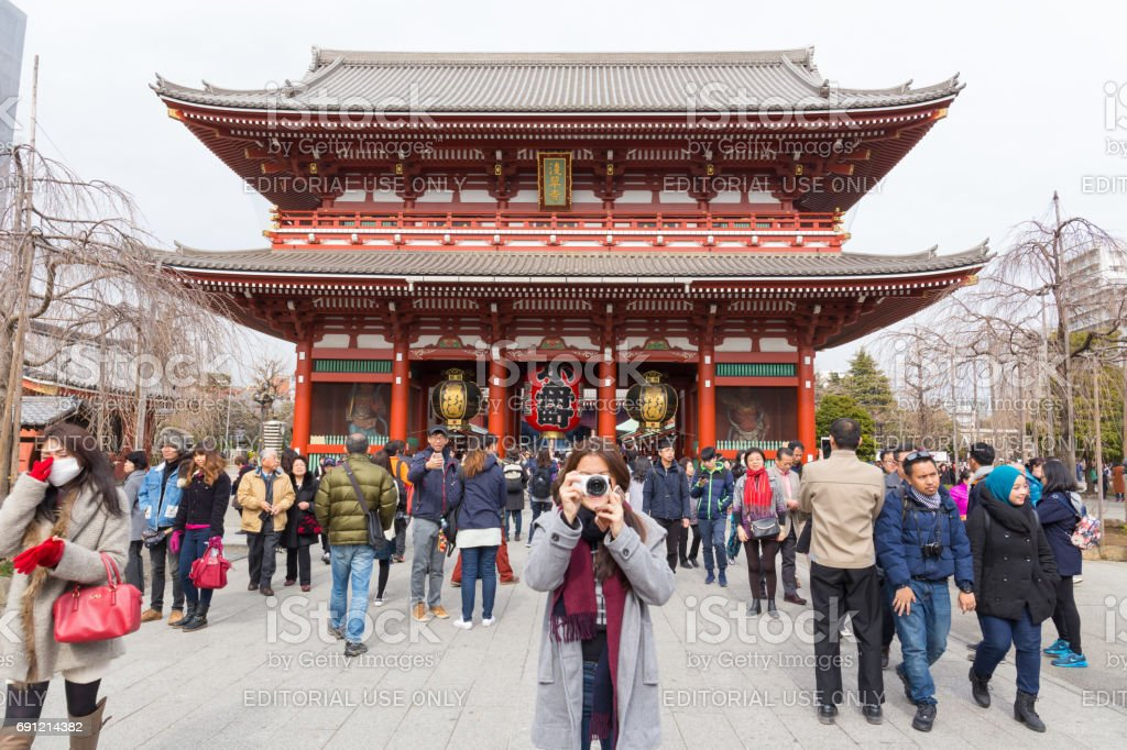 A lot of tourists go to see Hozomon, Treasure house gate of Sensoji temple February 18, 2017 in Tokyo, Japan stock photo