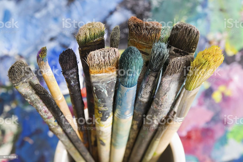 Lot of used paint brushes stock photo