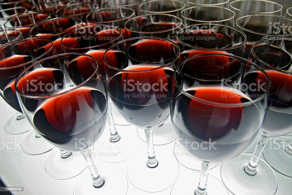 A lot of wine glasses filled with red wine stock photo