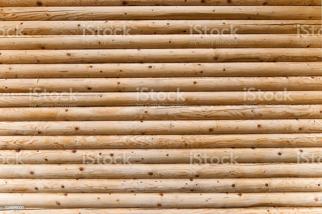 A lot of wooden logs that are stacked on top of each other  stock photo